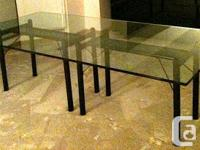 MODERN GLASS TABLE FOR SALE. $1200.00 Dimensions are 8