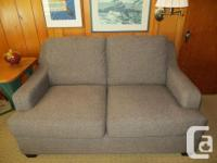 This brand new, modern loveseat or small sofa was