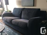 Modern Natuzzi sofa purchased at Sagers with navy blue