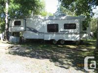 1999 Montana 5th Wheel/Cabana found in Seasonal lot on