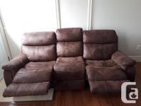 Dual reclining microfibre upholstery couch. 2 years old