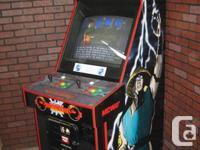 Selling this Mortal Kombat II arcade machine in very