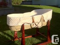 Lovely moses basket and stand, lined with plush cream
