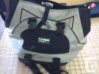 Universal sport bag dog carrier. Held my 20lb dog on my