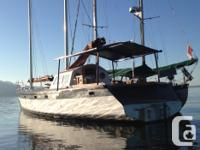 wooden..52 ft motorsailor..is a live aboard..on pin in