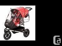 Mountain Buggy Urban Jungle stroller. Includes rain