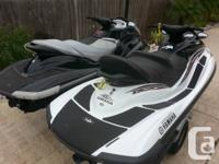 The black one with gray seat is a 2007 Yamaha