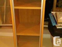 * Light maple cabinet - 2 adj. shelves & glass door,
