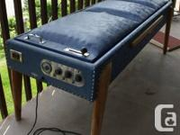Circa 1960s vibrating massage therapy bed. Made in