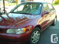 2000 Toyota Corolla, automatic, red, only 240 K, $2,500