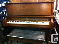 Beautiful Mozart upright grand piano for sale.  Built