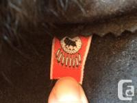 Barely worn black mukluks with rabbit fur and beading