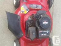 """20"""" Murray side discharge gas powered lawnmower."""