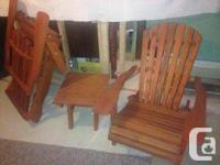 2 Folding up solid lumber Muskoka chairs as well as a