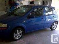 Chevrolet aveo 2005 hatchback blue. Was my husband's
