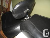 Two piece mustang seat with adjustable driver backrest.