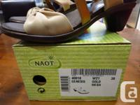 These NAOT slip-on sandals were purchased a few years