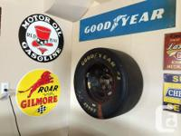 nascar tire, large shell sign, large two sided lighted