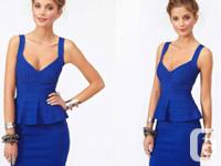 Awesome blue bandage dress featuring a v neckline and
