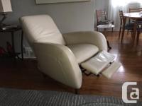 100% Italian leather recline chair. Hardwood frame .