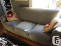 1st the Good News -green Natuzzi sofa purchased new in