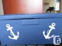 Old trunk painted navy blue with white nautical compass