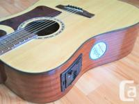 This almost like-new acoustic/electric guitar has