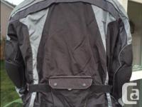 Great waterproof riding jacket, amour/padding on