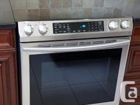 Electric Samsung slide-in range. Purchased and