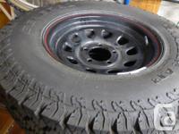 2 General Grabber 27x850R14 winter tires on Black