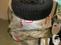 Snow tires collecting dust in the basement. Tread is