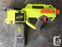 Each gun comes with some darts or discs, some glow in