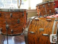Vintage Pearl drums with a tiger stripe finish, have