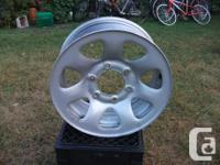 New condition, off spare tire that was never used. 3