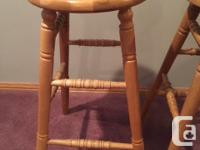 Two solid oak bar stools bought from an oak furniture