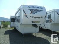New 2013 Keystone Avalanche 330RE quad slide 5th wheel.