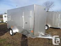 2013 EZEC-DL 6x12.  Has a side access door and a ream
