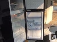 New Igloo fridge freezer. Used 2 weeks as replacement