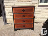 This is a new dresser made by Kimball. The drawers are