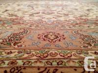 This is a hand knotted persian rug made of kork wool