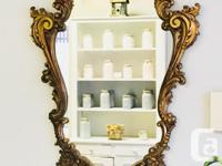 Gorgeous gold gilt antique wall mirror. This is wood...