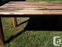 This bold solid Walnut dining table features a