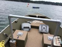 A sturdy and fun boat. Swivel seats, crabpots. Very