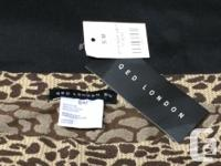 """New with tags, form fitting skirt. Measures 30"""" waist,"""
