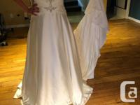New, size 12 wedding dress. Ivory with integrated