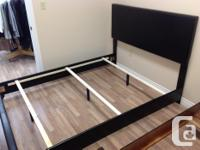 Brand name new king size bed with vinyl padding