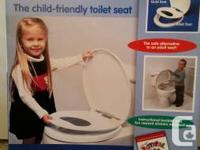New in box - Dr Merry's Pottypal toilet seat.  Allows