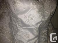 Brand new wedding dress for sale . never worn. smoke
