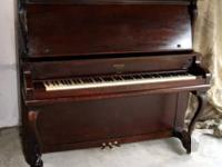 """This is a Newcombe piano made in Canada. It is 54"""" tall"""