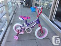 Beautiful toddler girls bike with training wheels in